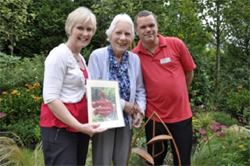 BLOOMING MARVELLOUS. Alison Bremner, Manager at Colten Care's Braemar Lodge care home in Salisbury, holds the City Gardens certificate. With her in the garden is resident Gladys West and activity organiser Martin Cannings