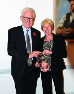 Norman Lamb presents Julie Bristow with the engraved vase