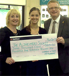 Local Fundraisers Deliver Cheque To The Alzheimer's Society