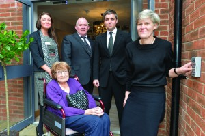 Milly Mitten and MP Kate Green (front l and r) open the new accommodation, with Joanna Fryers, Dylan Southern & Chris McGoff