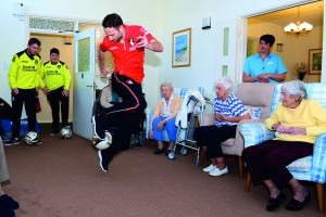 Marc Pugh showing residents some tricks