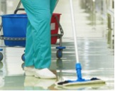 Care Worker Mopping Hospital Floor
