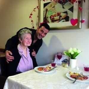 Britten Court resident Olive Gooch enjoying her special wedding anniversary meal, with kitchen assistant Karmal Dejedda.