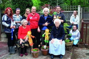 Students show the residents of Churchfield Care home the fruits of their labour.JPG-orig