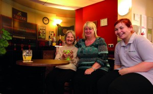 L-R Resident June Ladbroke with Mary Tasker, service manager, and Danielle Print, support work at the 'pop-up pub' at the Hawthorns Care Home (1280x789)