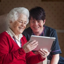 Old Woman and Nurse with iPad