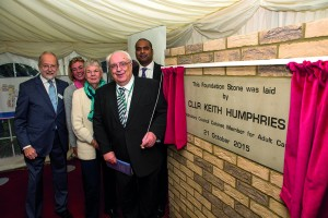 Cllr Keith Humphries (holding the curtain cord) l-r behind - Don Wood (Chairman of OSJCT Trustees), Pip Davies, Mrs Sue Goodson, Robin Khokhar (Asst Ops Director, Wiltshire)