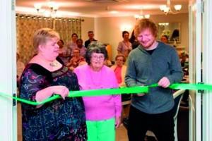 Ed Sheeran cutting ribbon low res