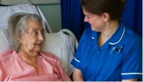 NHS nurse and elderly patient
