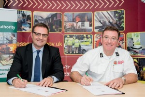 Signing-of-fire-safety-agreement-Andrew-and-Adam-low-res