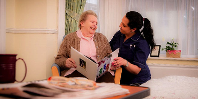 Nurse Caring For Elder