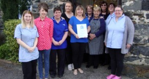 Staff at Cartref Y Borth with their award.