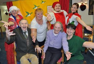 Panto fun: Stanley Crowe, 90, and Marion Minns, 86, both residents at Colten Care's Woodpeckers home, with Janie Pearman, Home Manager, and cast members from the Carousel Theatre Company.