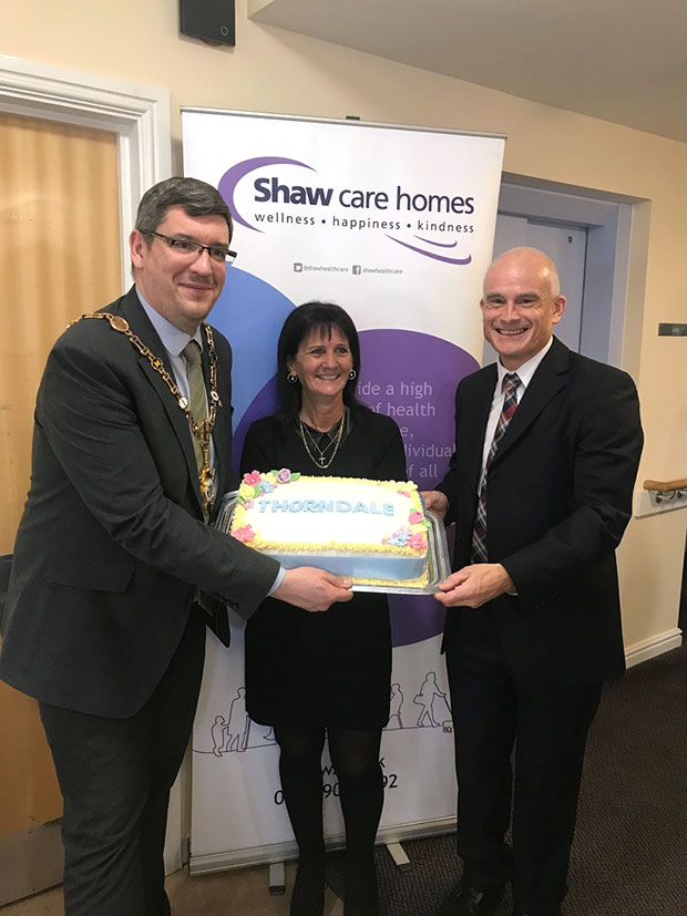 L R Scott Edwards Mayor of Kettering home manager Teresa Taylor and Russell Brown Shaws chief financial officer