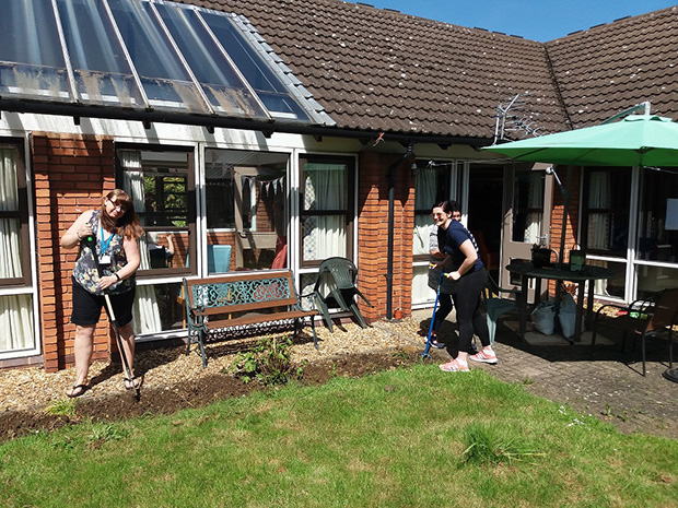Volunteers get stuck in on revamping the garden at Shaws Lancum House care home