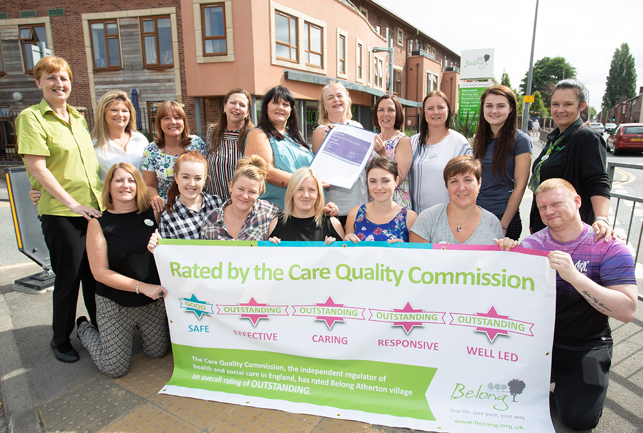 Staff at Belong Atherton celebrate the care villages outstanding inspection report