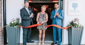 Cheryl-Baker-with-home-manager-Jeff-Levine-and-CEO-of-Oakland-Care-Harnoop-Atkar