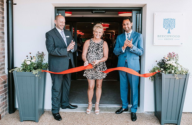 Cheryl Baker with home manager Jeff Levine and CEO of Oakland Care Harnoop Atkar