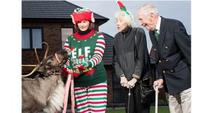 Veko-the-reindeer-with-Kyla-Byrne-(elf)-and-residents-Alison-Rimmer-and-Eddi