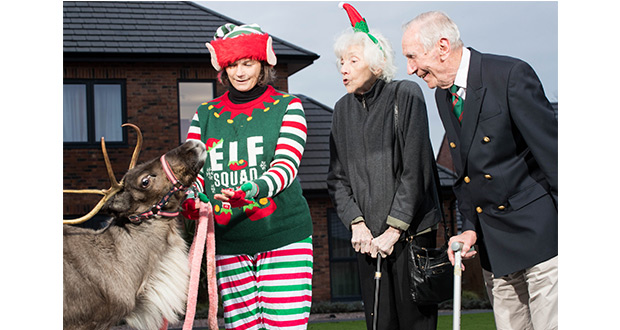 Veko the reindeer with Kyla Byrne elf and residents Alison Rimmer and Eddi