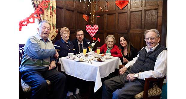 Residents at Stretton Hall enjoying a St Valentine's Day themed afternoon tea