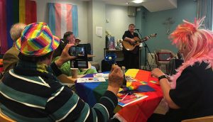 Residents-and-visitors-to-Belong-Crewe-enjoy-a-performance-by-sing-songwriter-and-equal-rights-campaigner,-Claire-Mooney